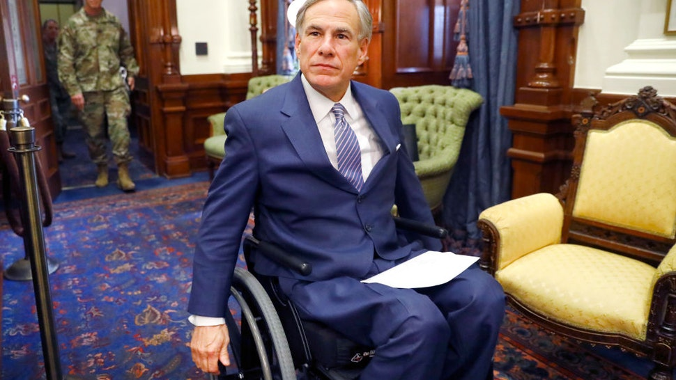 Texas Governor Greg Abbott arrives for his COVID-19 press conference at the Texas State Capitol in Austin.