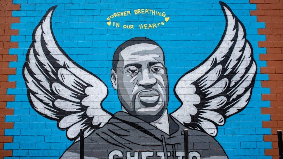 HOUSTON, TX - JUNE 02: A mural of George Floyd is shown painted on the side of Scott Food Mart in the Third Ward before a march in his honor on June 2, 2020 in Houston, Texas. Family members of Floyd were scheduled to participate in a march from Discovery Green to City Hall with support from the local chapter of Black Lives Matter. Floyd, a former resident of the Third Ward, died May 25 while in police custody in Minneapolis, Minnesota.