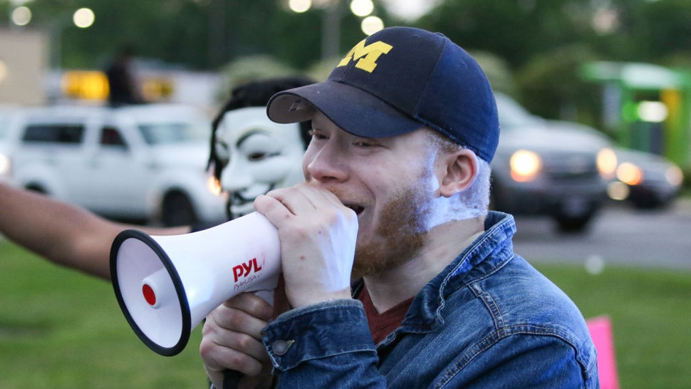 Sir Maejor Page, a local activist, speaks to demonstrators during a march along Reynolds Road on June 1, 2020, in Toledo, Ohio.