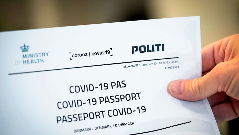 Picture taken on July 10, 2020 shows a Covid-19 passport printed from a website in Copenhagen, on July 10, 2020. - With the new Covid-19 passport issued be the Danish authorities, Danes now have official documentation for testing on their travels abroad. (Photo by Ida Marie Odgaard / Ritzau Scanpix / AFP) / Denmark OUT (Photo by IDA MARIE ODGAARD/Ritzau Scanpix/AFP via Getty Images)