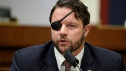 Representative Dan Crenshaw, a Republican from Texas, speaks during a House Homeland Security Committee security hearing in Washington, D.C., U.S., on Thursday, Sept. 17, 2020. The hearing focused on international terrorism threats, the rise in domestic terrorism incidents and recent shootings as well as election security and cyber threats.