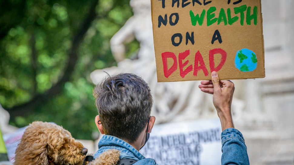 MANHATTAN, NEW YORK, UNITED STATES - 2020/09/20: Participant holding a sign at the climate march. A coalition of climate, Indigenous and racial justice groups gathered at Columbus Circle to kick off Climate Week with the Climate Justice Through Racial Justice march.