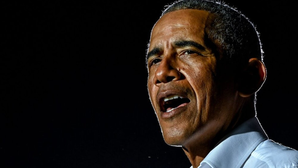 TOPSHOT - Former US President Barack Obama speaks at a drive-in rally as he campaigns for Democratic presidential candidate former Vice President Joe Biden in Miami, Florida on November 2, 2020.