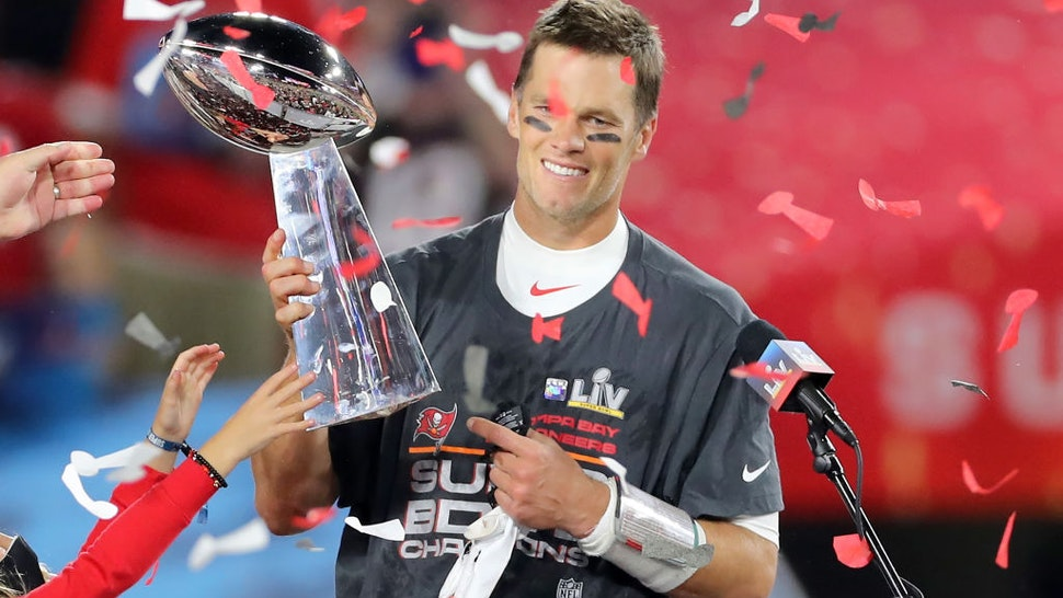 Super Bowl MVP Tom Brady (12) of the Buccaneers holds the Lombardi Trophy after the Super Bowl LV game between the Kansas City Chiefs and the Tampa Bay Buccaneers on February 7, 2021 at Raymond James Stadium, in Tampa, FL.