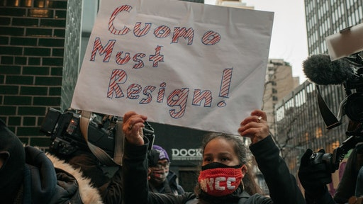 Demonstrators call on New York Gov. Andrew Cuomo to resign at a rally on March 2, 2021 in New York City.