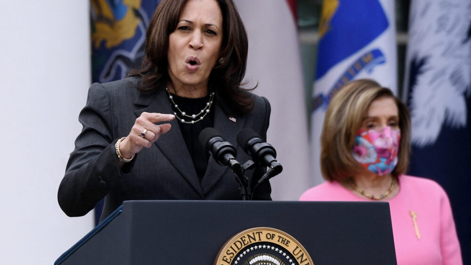 US Vice President Kamala Harris speaks as House Speaker Nancy Pelosi (D-CA) listens during an event on the American Rescue Plan in the Rose Garden of the White House in Washington, DC, on March 12, 2021.