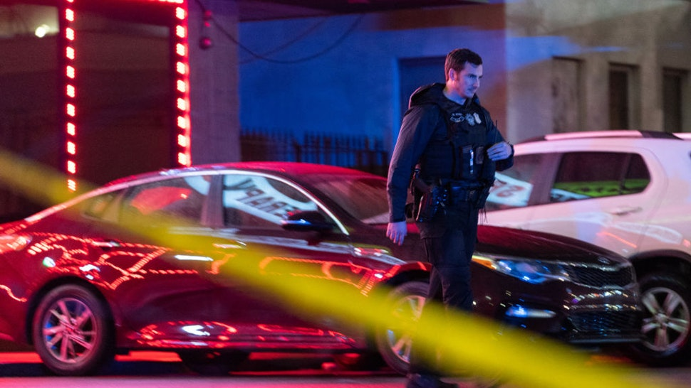 Law enforcement personnel leave a massage parlor where a person was shot and killed on March 16, 2021, in Atlanta, Georgia. - Eight people were killed in shootings at three different spas in the US state of Georgia on March 16 and a 21-year-old male suspect was in custody, police and local media reported, though it was unclear if the attacks were related. (Photo by Elijah Nouvelage / AFP) (Photo by ELIJAH NOUVELAGE/AFP via Getty Images)