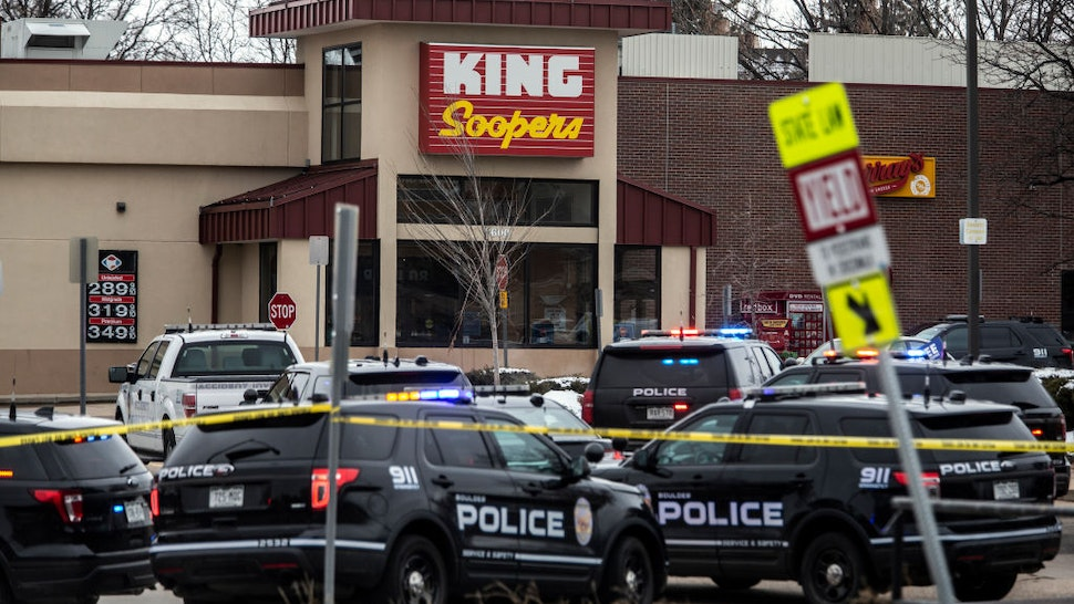 Police respond at a King Sooper's grocery store where a gunman opened fire on March 22, 2021 in Boulder, Colorado.
