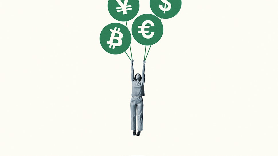 Young woman hanging from large green currency symbol balloons against white background