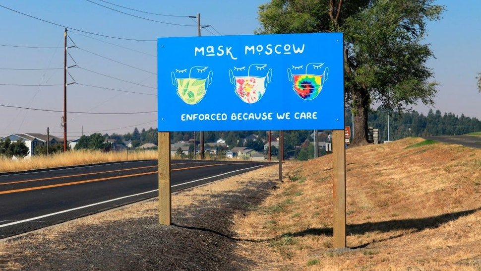 Highway sign reminding city citizens to wear masks