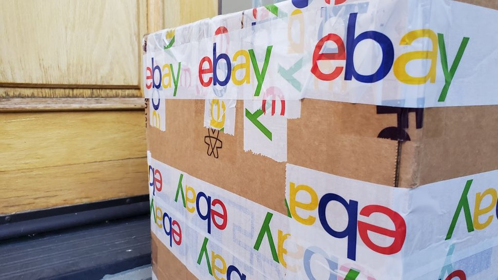 lose-up of the eBay logo featured on the packing tape securing a large cardboard shipping box in San Ramon, California, USA, November 8, 2020. (Photo by Smith Collection/Gado/Getty Images)