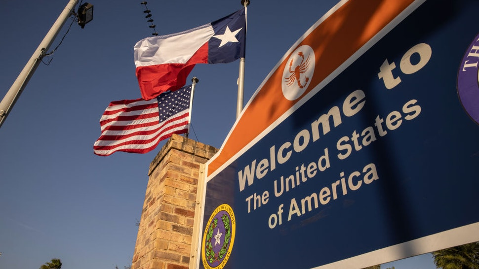 ROWNSVILLE, TEXAS - FEBRUARY 24: The U.S. and Texas flags fly near the U.S.-Mexico border on February 24, 2021 in Brownsville, Texas. (Photo by John Moore/Getty Images)