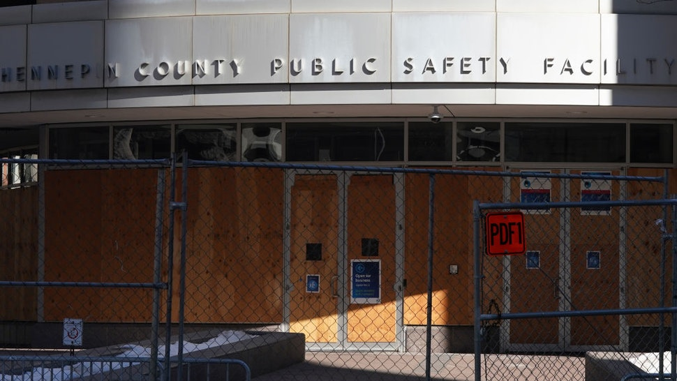 """Chain link fence with barbed wire, concrete barriers, and concertina wire surrounded the Hennepin County Public Safety Facility, the Hennepin County Government Center and City Hall as crews worked to fortify the buildings in preparation for Derek Chauvin""""u2019s trial in the killing of George Floyd."""