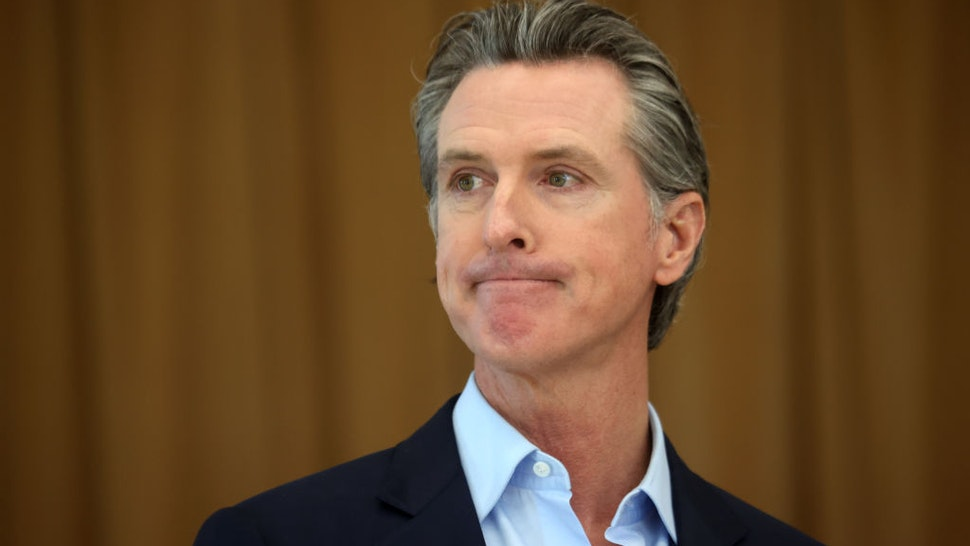 ALAMEDA, CALIFORNIA - MARCH 16: California Gov. Gavin Newsom looks on during a news conference after he toured the newly reopened Ruby Bridges Elementary School on March 16, 2021 in Alameda, California. Gov. Newsom is traveling throughout California to highlight the state's efforts to reopen schools and businesses as he faces the threat of recall. (Photo by Justin Sullivan/Getty Images)