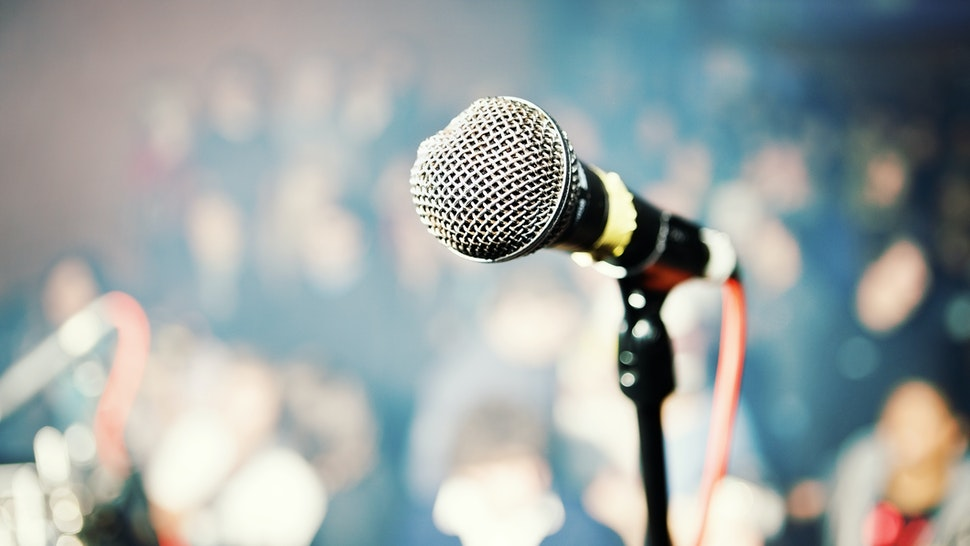 Performer's point of view over microphone into theater audience - stock photo