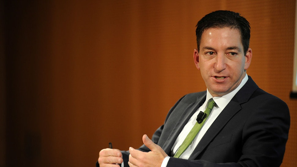 Glenn Greenwald speaks during the presentation of his book 'No Place to Hide: Edward Snowden, The NSA, And The U.S. Surveillance State' on May 26, 2014 in Milan, Italy.