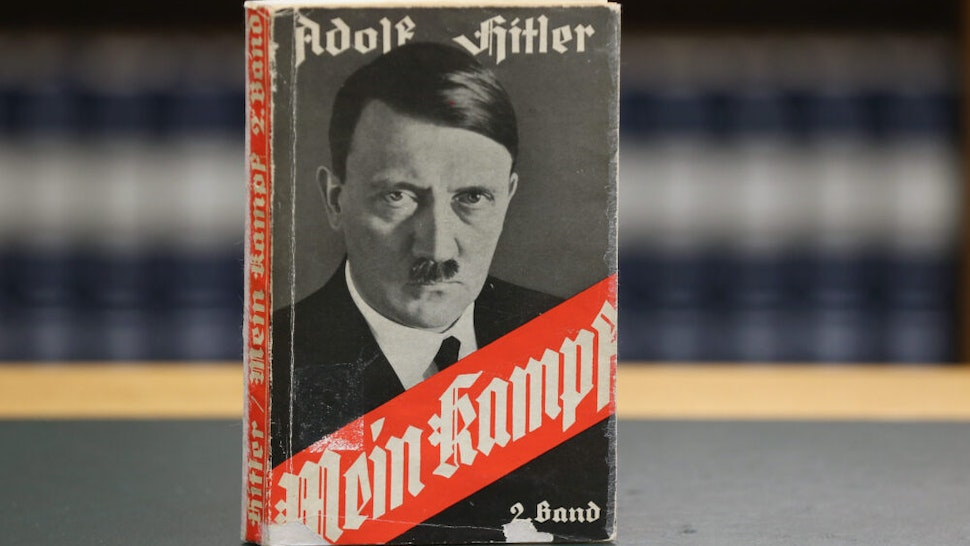 "BERLIN, GERMANY - DECEMBER 15: A 1941 edition of Adolf Hitler's ""Mein Kampf"" (""My Struggle"") stands at the library of the Deutsches Historisches Museum (German Historical Museum) on December 15, 2015 in Berlin, Germany. The state of Bavaria took possession of the copyright to the book after World War II, though the copyright is due to expire and the book will enter the public domain on January 1, 2016. Germany will continue to heavily restrict publication of the book in Germany though it will have little control over publications abroad. Hitler wrote the book that is both an autobiography and also presents his political vision while he was a prisoner in Germany in he 1920s."
