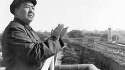 (Original Caption) Mao Tse-Tung on a balcony clapping his hands. Undated photograph.