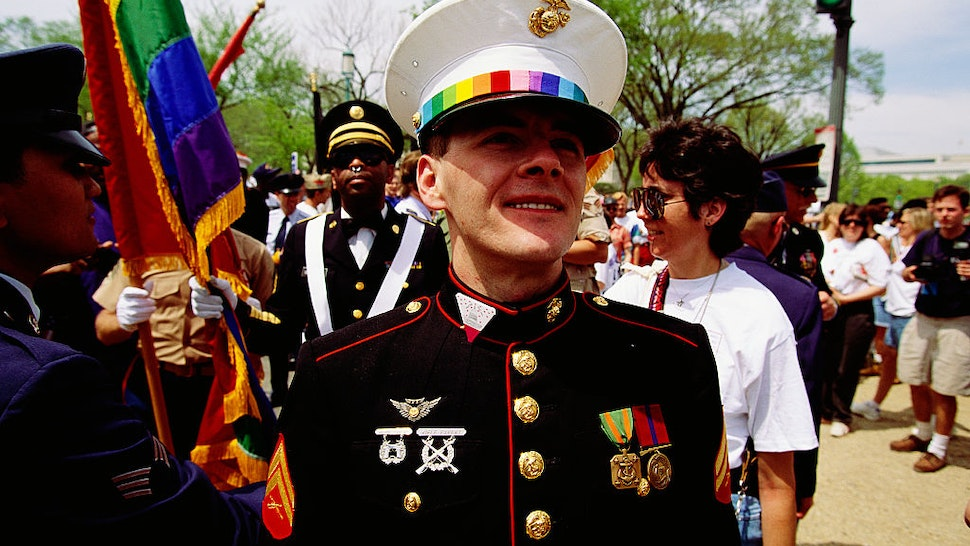 Gay marine standing with other participants at the 1993 March on Washington for Lesbian, Gay, and Bisexual Rights and Liberation. (Photo by © Shepard Sherbell/CORBIS SABA/Corbis via Getty Images)