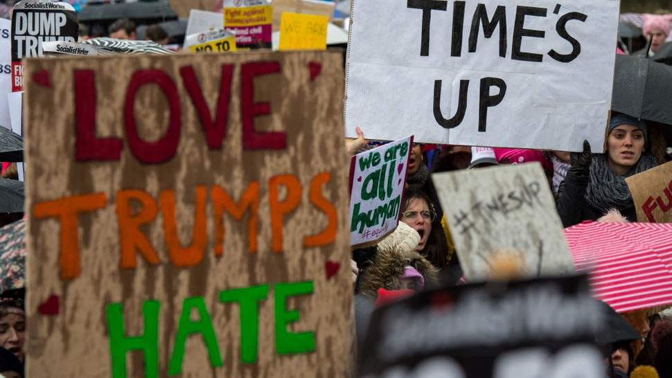 LONDON, ENGLAND - JANUARY 21: Women's rights demonstrators hold placards and chant slogans during the Time's Up rally at Richmond Terrace, opposite Downing Street on January 21, 2018 in London, England. The Time's Up Women's March marks the one year anniversary of the first Women's March in London and in 2018 it is inspired by the Time's Up movement against sexual abuse. The Time's Up initiative was launched at the start of January 2018 as a response to the #MeToo movement and the Harvey Weinstein scandal.