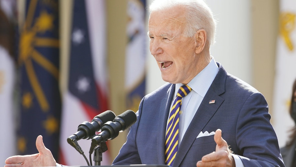 """U.S. President Joe Biden speaks during an event in the Rose Garden of the White House in Washington, D.C., U.S., on Friday, March 12, 2021. Biden offered a Fourth of July goal for the U.S. to begin returning to normal as """"light in the darkness"""" to a weary nation on Thursday, counting on a rapidly expanding supply of coronavirus vaccine to raise American hopes."""