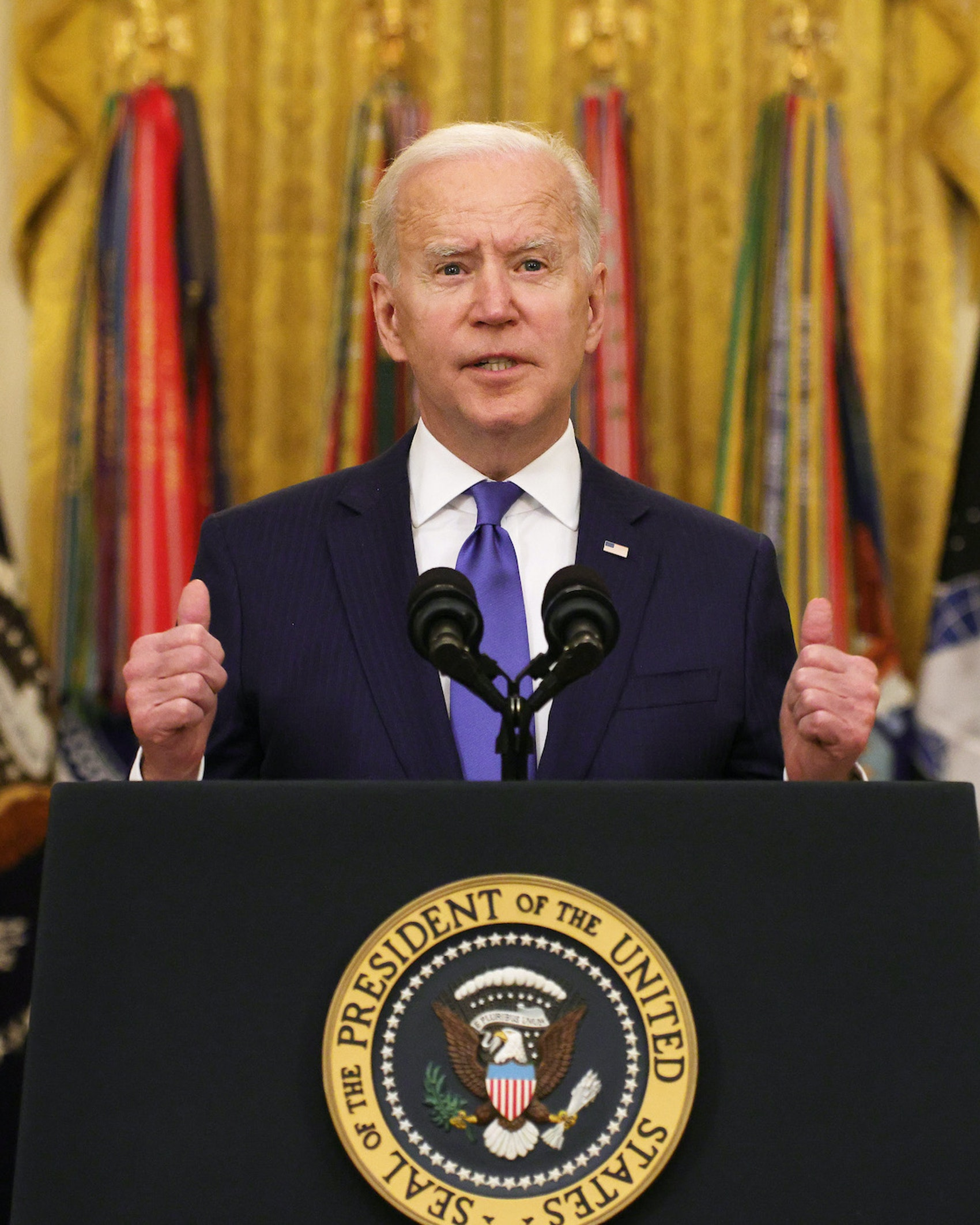 U.S. President Joe Biden delivers remarks on International Women's Day as Air Force General Jacqueline Van Ovost (L) and Army Lieutenant General Laura Richardson (R) listen during an announcement at the East Room of the White House March 8, 2021 in Washington, DC. President Biden announced the nominations of General Van Ovost and Lieutenant General Richardson to positions as 4-star combatant commanders. They will become the second and the third women to lead a combatant command in American history. (Photo by Alex Wong/Getty Images)