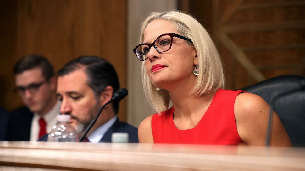 """WASHINGTON, DC - MAY 14: Senate Aviation and Space Subcommittee ranking member Sen. Kyrsten Sinema questions witnesses during a hearing in the Dirksen Senate Office Building on Capitol Hill on May 14, 2019 in Washington, DC. In the wake of President Donald Trump's orders to create a military Space Force, NASA Administrator Jim Bridenstine testified about """"The Emerging Space Environment: Operational, Technical, and Policy Challenges."""""""
