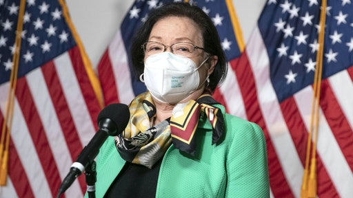 Senator Mazie Hirono, a Democrat from Hawaii, wears a protective mas while speaking to members of the media outside a Senate Judiciary Committee confirmation hearing for Merrick Garland, U.S. attorney general nominee for U.S. President Joe Biden, in Washington, D.C., U.S., on Monday, Feb. 22, 2021. Garland signaled he'll make decisions independently from Biden and is pledging he'll take the lead in prosecuting participants in the mob that attacked the Capitol on Jan. 6.