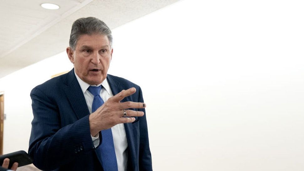Senator Joe Manchin, a Democrat from West Virginia, speaks to members of the media while departing a bipartisan Senate luncheon in Dirksen Senate Office Building in Washington, D.C., U.S., on Wednesday, March 3, 2021. President Biden's imperative of swiftly passing his $1.9 trillion pandemic-relief program faces one of its final hurdles, settling disputes among Senate Democrats over how to ensure aid gets to those who truly need it.