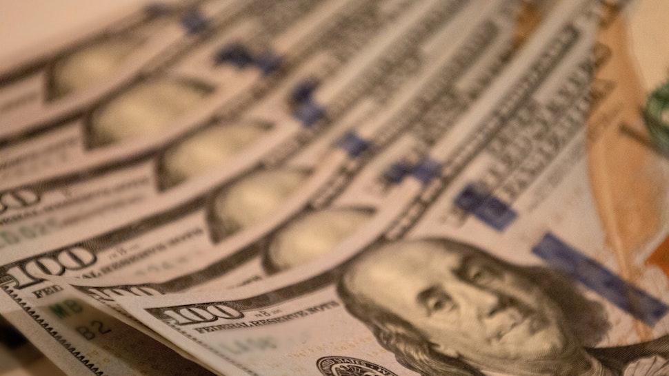 $100 bills (Catherine McQueen/Getty Images)