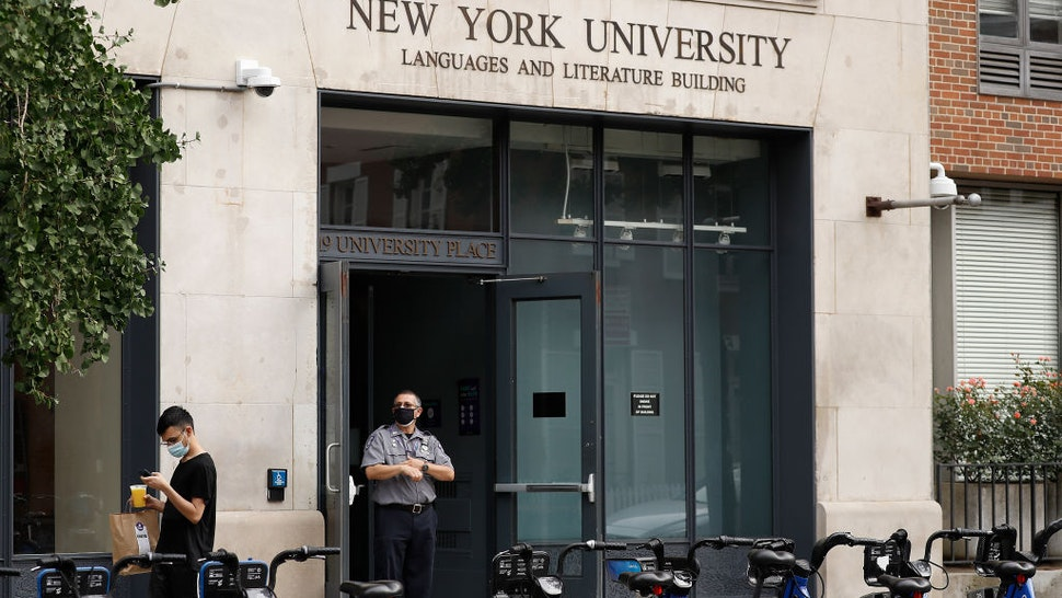 NEW YORK, NEW YORK- SEPTEMBER 17: A security guard stand outside a New York University building during Phase 4 of re-opening following restrictions imposed to slow the spread of coronavirus on September 17, 2020 in New York City . The fourth phase allows outdoor arts and entertainment, sporting events without fans and media production.
