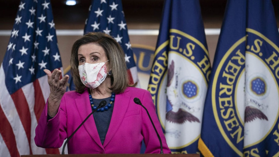 U.S. House Speaker Nancy Pelosi, a Democrat from California, wears a protective mask while speaking during a news conference at the U.S. Capitol in Washington, D.C., U.S., on Thursday, Feb. 25, 2021. House Democrats released an updated version of their coronavirus stimulus bill Wednesday, adding funds for foreign aid, tribal governments and housing, and other measures ahead of a vote later this week.