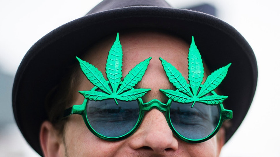 A demonstrator wears a pair of hemp glasses during a demonstration in favour of legalising cannabis in Berlin, Germany, 16 May 2015. The 'Global Marijuana March' is taking place with rallys worldwide. Photo: Gregor Fischer/dpa | usage worldwide