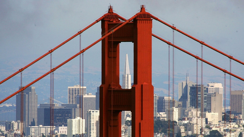SAUSALITO, CA - JUNE 20: The Transamerica Pyramid building is seen through the north tower of the Golden Gate Bridge June 20, 2007 as seen from Sausalito, California. Pacific Gas and Electric has launched an estimated $1.5 million research program to study the possibility of submerging turbines under the water to gather energy from tidal flows. A previous study conducted by the Electric Power Research Institute in 2006 came to conclude that the tides that pass under the iconic Golden Gate bridge are the best on the West Coast of the U.S. to generate power.