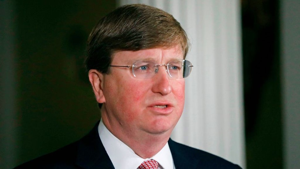 Mississippi Republican Gov. Tate Reeves delivers a televised address prior to signing a bill retiring the last state flag with the Confederate battle emblem during a ceremony at the Governor's Mansion in Jackson, Mississippi, on June 30, 2020. (Photo by ROGELIO V. SOLIS/POOL/AFP via Getty Images)