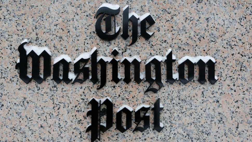 WASHINGTON, DC - JANUARY 23: Washington Post logo outside of the building covered with snow. (Photo by Oliver Contreras/For The Washington Post via Getty Images)