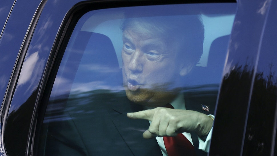 WEST PALM BEACH, FLORIDA - JANUARY 20: Outgoing US President Donald Trump waves to supporters lined along on the route to his Mar-a-Lago estate on January 20, 2021 in West Palm Beach, Florida. Trump, the first president in more than 150 years to refuse to attend his successor's inauguration, is expected to spend the final minutes of his presidency at his Mar-a-Lago estate in Florida.