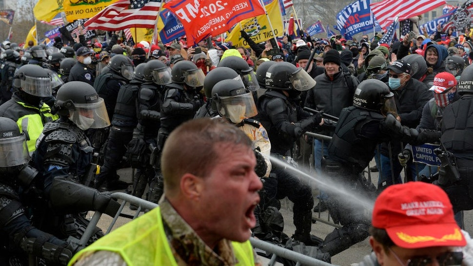 TOPSHOT - Trump supporters clash with police and security forces as people try to storm the US Capitol in Washington D.C on January 6, 2021. - Demonstrators breeched security and entered the Capitol as Congress debated the a 2020 presidential election Electoral Vote Certification. (Photo by Joseph Prezioso / AFP) (Photo by