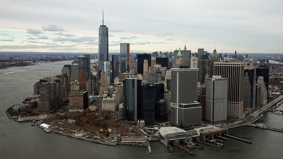 NEW YORK, NY - NOVEMBER 12: One World Trade Center towers over lower Manhattan on November 12, 2013 in New York City. The building was deemed the tallest building in North America today; the title was previously held by Willis Tower in Chicago (previously titled Sears Tower). (Photo by