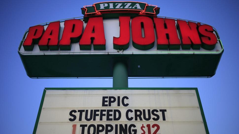 Signage outside a Papa John's International Inc. pizza restaurant in Louisville, Kentucky, U.S., on Monday, Feb. 22, 2021.