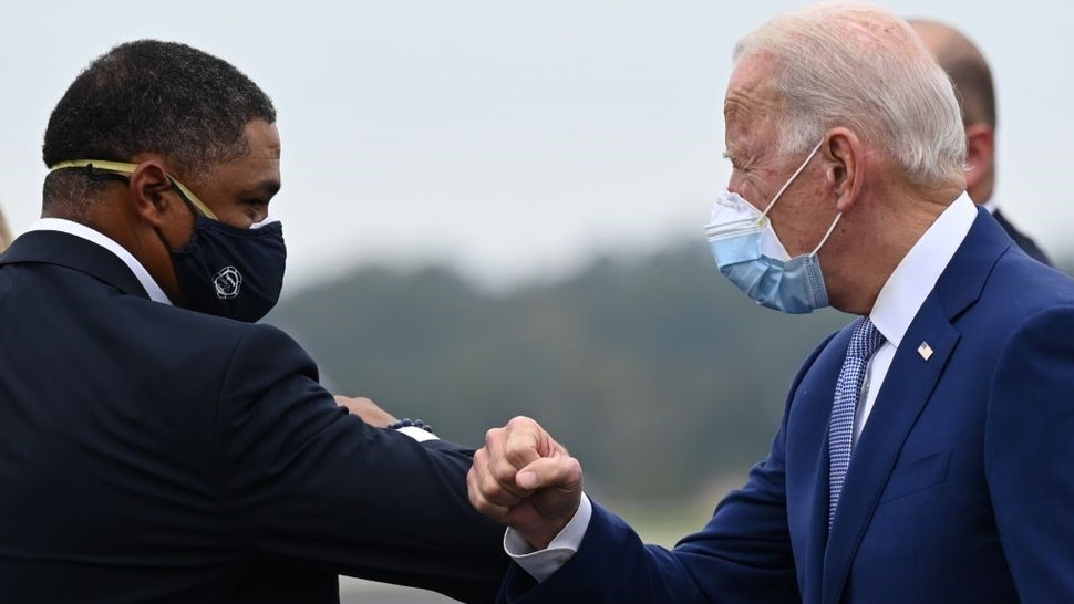 Democratic presidential candidate Joe Biden is greeted by US Congressman Cedric Richmond, D-LA as he arrives in Columbus, Georgia, on October 27, 2020. (Photo by JIM WATSON / AFP) (Photo by