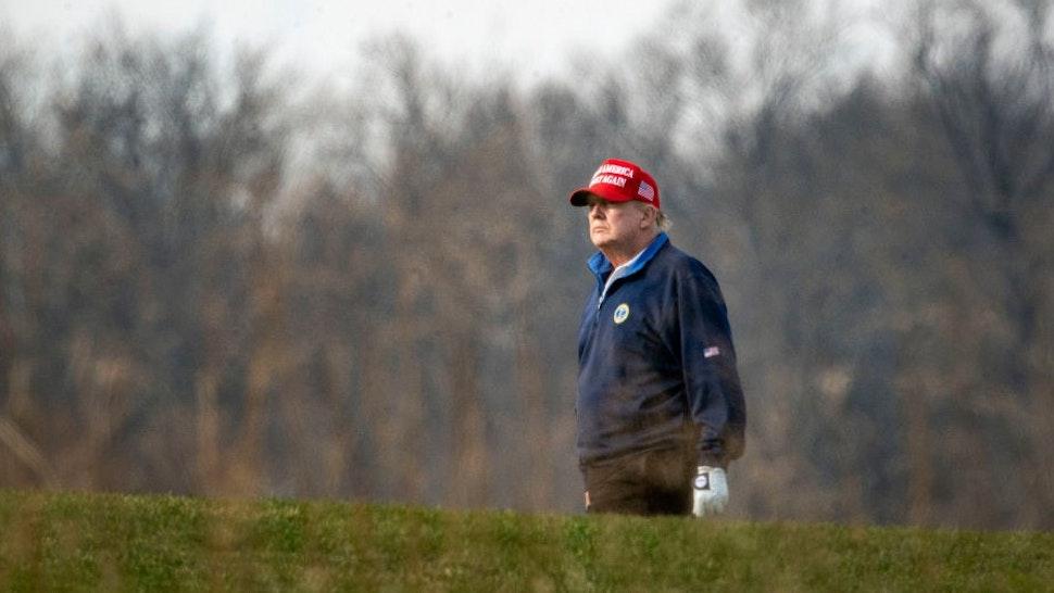 STERLING, VA - DECEMBER 13: U.S. President Donald Trump golfs at Trump National Golf Club on December 13, 2020 in Sterling, Virginia. (Photo by