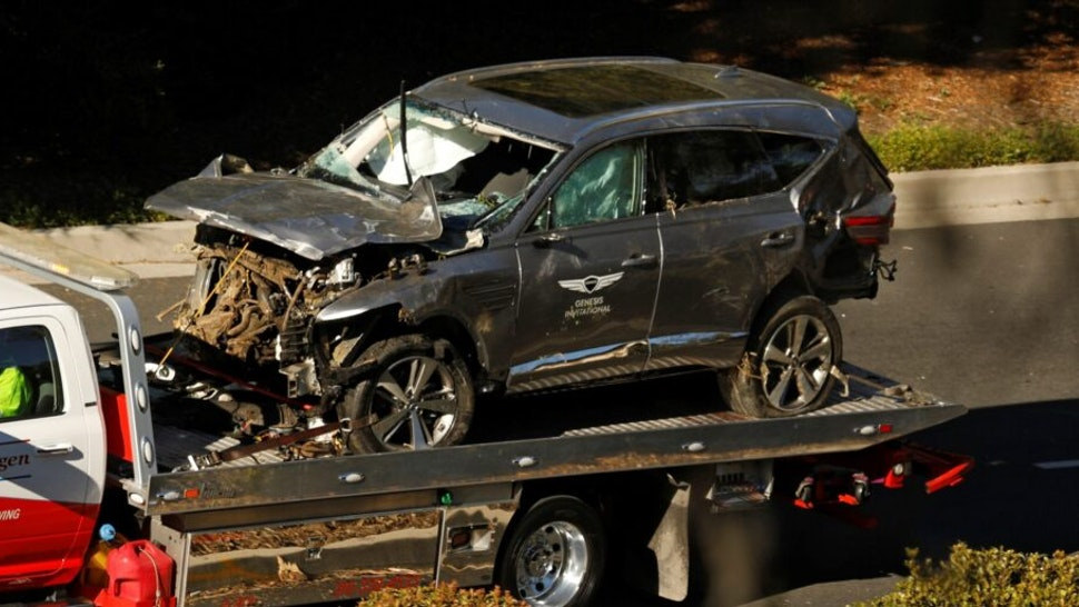 Los Angeles, California-The vehicle driven by Tiger Woods is towed away on Hawthorne Blvd after he ran off the road and sustained injuries. (