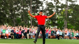 AUGUSTA, GEORGIA - APRIL 14: Tiger Woods of the United States celebrates after sinking his putt on the 18th green to win during the final round of the Masters at Augusta National Golf Club on April 14, 2019 in Augusta, Georgia. (Photo by