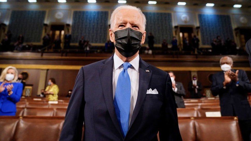 US-POLITICS-BIDEN US President Joe Biden arrives to address a joint session of Congress at the US Capitol in Washington, DC, on April 28, 2021. (Photo by Melina Mara / POOL / AFP) (Photo by MELINA MARA/POOL/AFP via Getty Images)