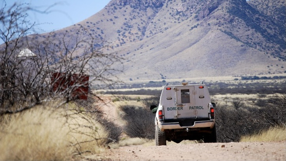 Border patrol truck with mountains - stock photo