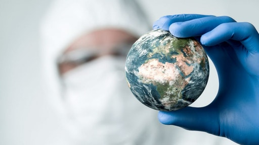 Pandemic concept, close up of scientist holdnig and analyzing planet earth.