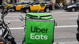 American online food ordering and delivery platform launched by Uber, Uber Eats, logo on a bicycle in Barcelona.