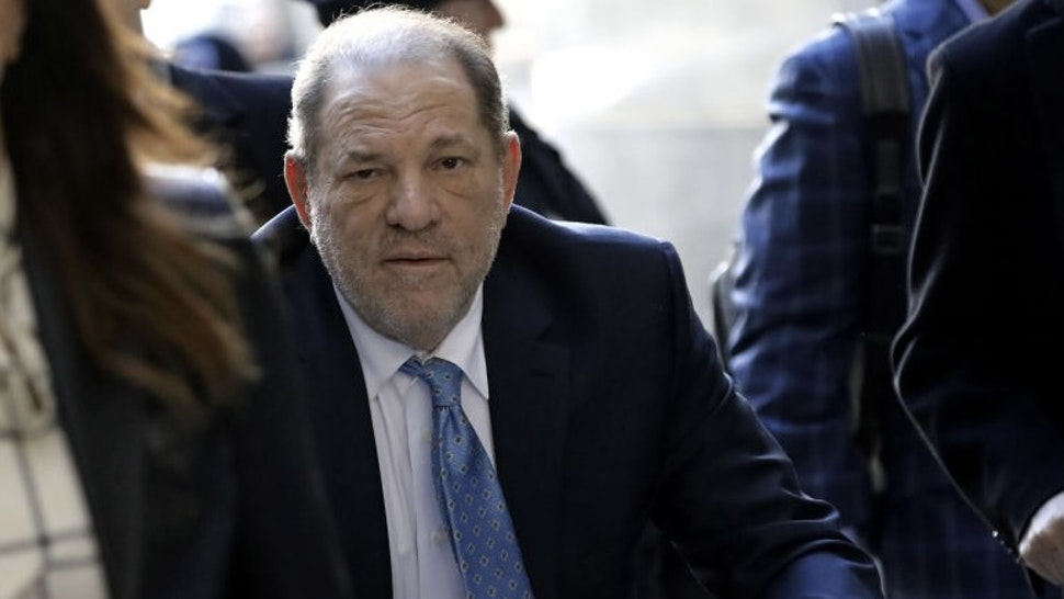 Harvey Weinstein, former co-chairman of the Weinstein Co., center, arrives with his attorney Donna Rotunno, left, at state supreme court in New York, U.S., on Monday, Feb. 24, 2020. Jurors at Weinstein's trial are set to resume deliberations Monday after signaling they are at odds on the top charges, AP reports. Photographer: Peter Foley/Bloomberg