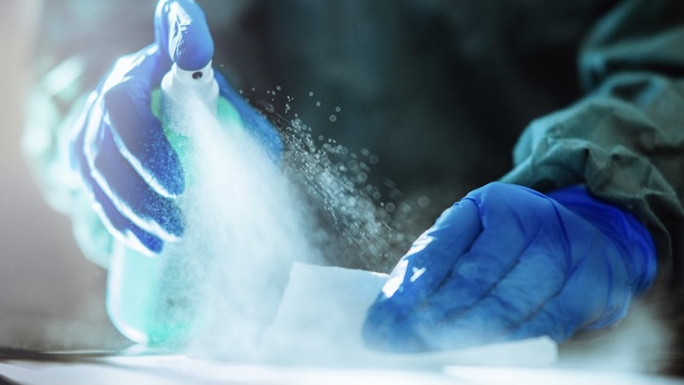 Spraying disinfection on surface. - stock photo Spraying disinfection on surface.